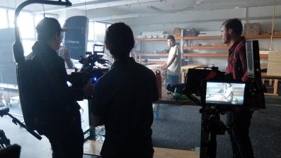 ad_indigenous_community_video_filmming_tyson_frigo_in_the_woodworking_studio_on_campus.jpg